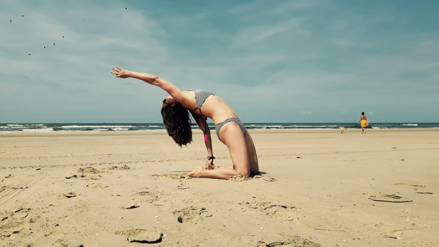 yoga backbend by the dutch beach