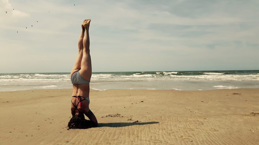 yoga headstand by the beach